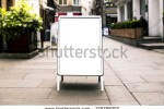 stock-photo-blank-outdoor-white-board-at-a-sidewalk-restaurants-advertising-278799302