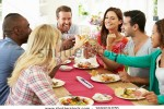 stock-photo-group-of-friends-making-toast-around-table-at-dinner-party-165815270