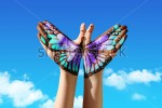 stock-photo-hand-and-butterfly-hand-painting-tattoo-over-a-blue-sky-concept-for-spiritual-symbol-of-soul-132696545