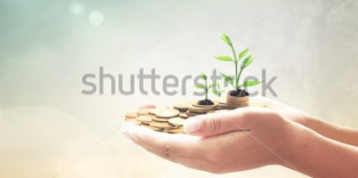 stock-photo-human-hand-holding-golden-coins-with-young-plant-over-blurred-beautiful-city-sunset-background-338719160