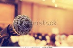 stock-photo-microphone-in-concert-hall-or-conference-room-with-defocused-bokeh-lights-in-background-extremely-256492474