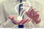 stock-photo-retro-image-of-businessman-holding-a-creative-light-bulb-icon-in-his-hands-conceptual-of-ideas-184359812